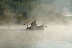 Fisher in the morning light Royalty Free Stock Image