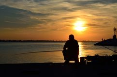 Fisher On The Pier Royalty Free Stock Photos