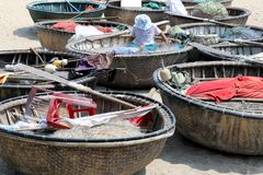 Fisher repairs his nets - Hoi An - Vietnam. Asien stock photography