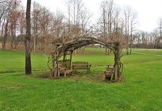 Fisher River Park in Dobson, North Carolina. Grape vine covered gazebo at Fisher River Park in Dobson, North Carolina.  The Fisher River, via the Yadkin River Royalty Free Stock Image