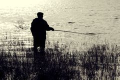 The fisher with a rod Royalty Free Stock Images