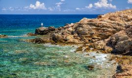 Fisher and sea. Lonely fisherman and sea of Crete, greece royalty free stock images
