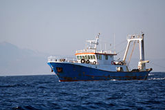 Fisher ship. In the sea royalty free stock photo