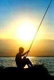 Fisher Silhouette bij Zonsondergang Royalty-vrije Stock Foto