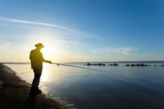 Fisher  silhouette at the sunset Royalty Free Stock Image