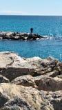 Fisher sur la mer Image stock