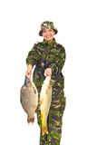 Fisher woman showing big carps Royalty Free Stock Images