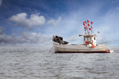 Fisherboat anchoring in the Baltic Sea Royalty Free Stock Photography