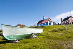 Fisherboat Sisimiut, Greenland. Fisherboat and historic houses in Sisimiut, Greenland Royalty Free Stock Photography