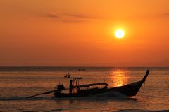 Fisherboat at sunset Stock Images