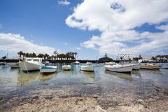 Fisherboats at the laguna charco de san gines Royalty Free Stock Photos