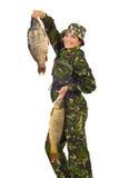 fisheren fiskar den stora kvinnan för den lyckliga holdingen Arkivbilder