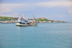 Fisheries boat and village scene along the coastal area Stock Photo