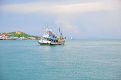 Fisheries boat and village scene along the coastal area Royalty Free Stock Images