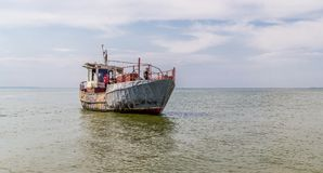 Fisheries on the Dnieper River. Old fishing trawler and sailors on the board Stock Image