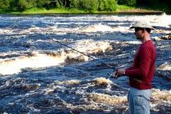 Fisherman. Man fishing on the river Stock Image