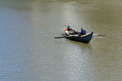 Fisherman. A fisherman sits alone in his boat stock photography