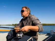 Fisherman. On a boat with spinning Royalty Free Stock Photos