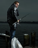 Fisherman. Lonely fisherman at the river royalty free stock photo