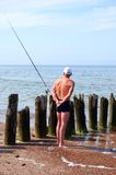 A fisherman. Middle aged fisherman at sea fishing. The Baltic sea Royalty Free Stock Image