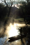 Fisherman. On the river in the morning sunlight royalty free stock images