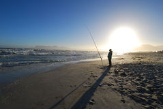 Fisherman. Patient fisherman on Strandfontein beach, Cape Town, South Africa Royalty Free Stock Photography