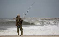 Fisherman. With waves and blue sky Stock Photography