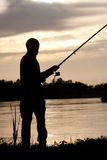 Fisherman. Silhouette of the fisherman, Fishing at the river at sunset, Beautiful landscape at sunset Stock Images