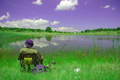 A fisherman. Fisherman cathing on the shore of lake in Macedonia royalty free stock image