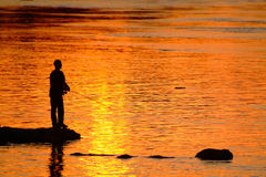 Fisherman 3. Fisherman and sunset Stock Image