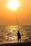 Fisherman. The fisherman on a sunset, summer Royalty Free Stock Image