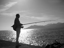 Fisherman. Lonely fisherman Stock Images