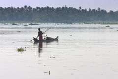 Fisherman. A lonely fisherman starts his duty in the early hours in Kerala, India Royalty Free Stock Photo