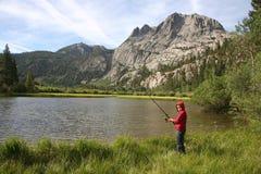 Fisherman. Young fisherman enjoying nature in the High Sierras of California royalty free stock photos