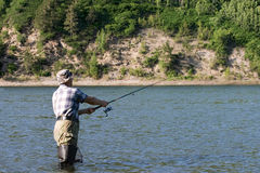 The fisherman. Fishing on the mountain river with fast current Stock Image