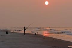 Fisherman. At the beach at dawn, Sunset Beach, North Carolina Stock Images