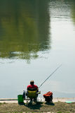 Fisherman. Angler on coast of river stock photography
