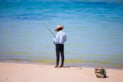 Fisherman. Fishing from beach. Lifestyle scene from Mauritius Stock Photography