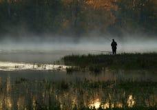 Fisherman. Old man fishing early morning Royalty Free Stock Image