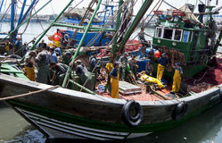 Fisherman aboard their trawler in the port of Essouaira, Morocco. Royalty Free Stock Photos