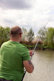 Fisherman in action, Fisherman holding rod in action.  Stock Photos