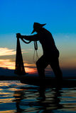 Fisherman. Action when fishing during sunset Stock Photography