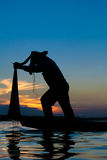 Fisherman. Action when fishing during sunset Royalty Free Stock Images