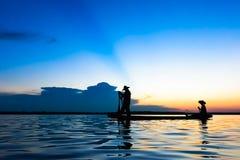 Fisherman. Action when fishing during sunset Stock Photo