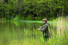 Fisherman in action Royalty Free Stock Photo