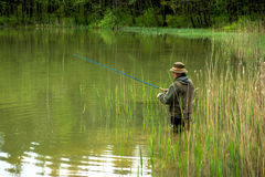 Fisherman in action Royalty Free Stock Images