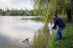 Fisherman in action. In spring time, fishing hobby activity Royalty Free Stock Photos