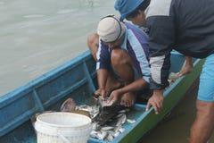Fisherman. Activity at Gajah Mungkur reservoir, Wonogiri, Jawa Tengah, Indonesia Royalty Free Stock Photo