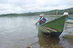 Fisherman. Activity at Gajah Mungkur reservoir, Wonogiri, Jawa Tengah, Indonesia Royalty Free Stock Photography