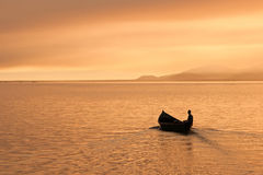 Fisherman alone on his boat Stock Photography